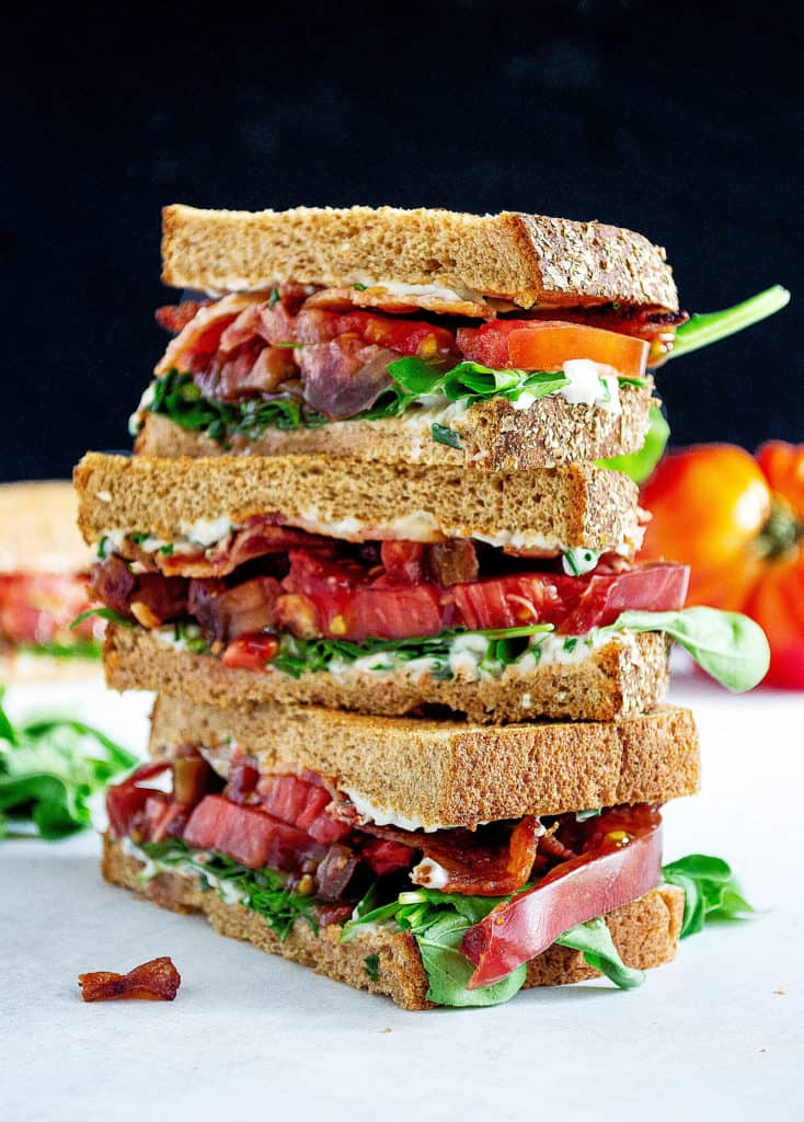 3 stacked halves of BLT sandwiches