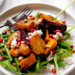 arugula salad with roasted beets, goat cheese, and pomegranate arils