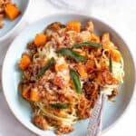 linguine with chorizo butternut swuash and sage in a blue bowl
