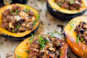Sausage-stuffed acorn squash with shiitakes and apples