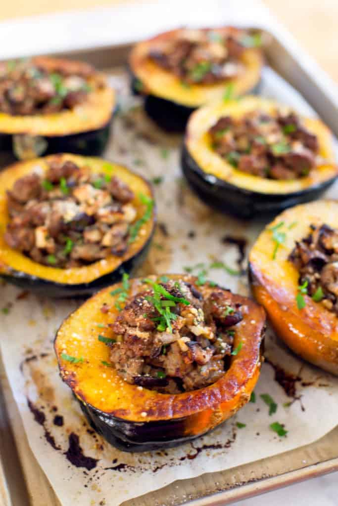 sausage stuffed acorn squash with shiitakes and apples