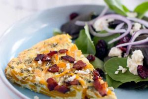 Spiralized butternut squash quiche with goat cheese, bacon, and sage