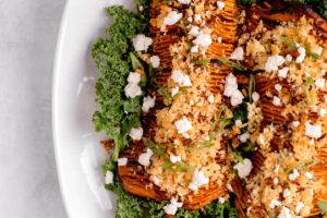 Sage and garlic hasselback butternut squash with apple cider bourbon glaze