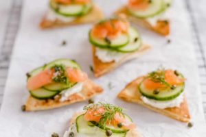 Baked pita bites with cream cheese, smoked salmon, and dill