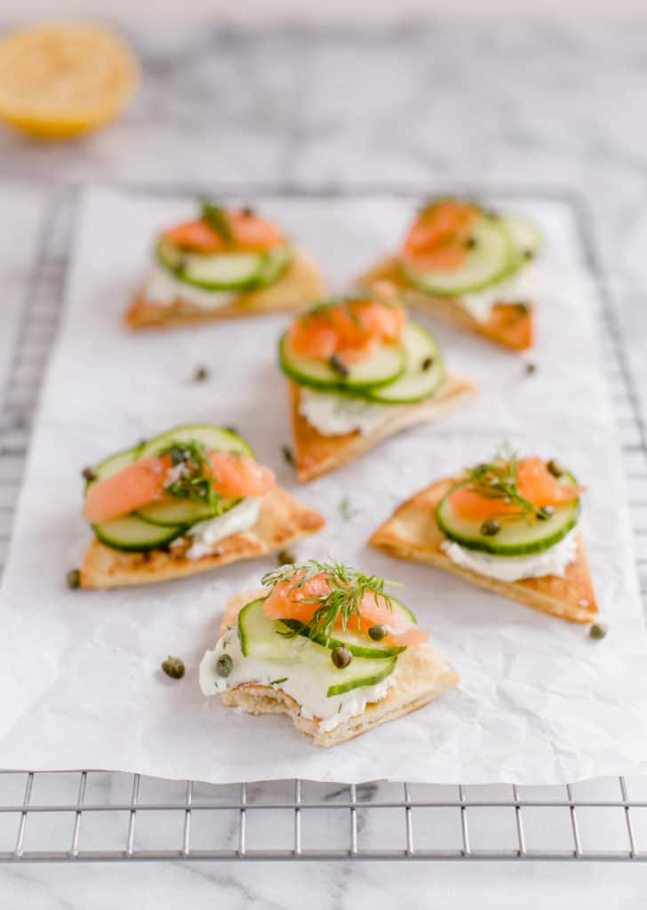 crispy pita bites with smoked salmon, cream cheese, cucumbers, and capers