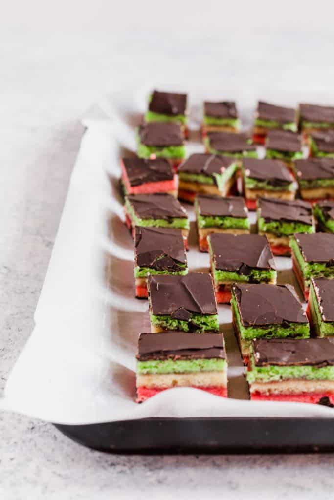 Italian rainbow cookies on baking tray with parchment paper