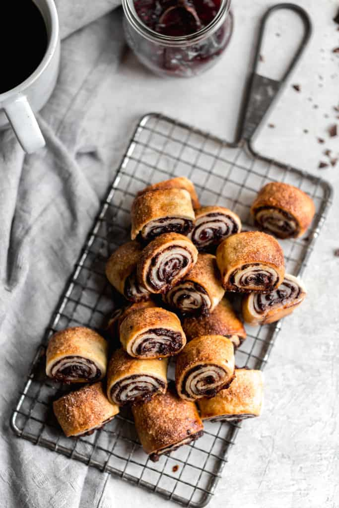 homemade chocolate rugelach with raspberry jam on a serving tray