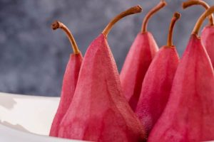 Red wine poached pears with parmesan and pistachios