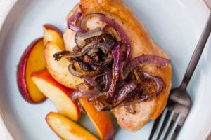 Sheet pan pork with red onions and peaches