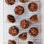 mini chocolate funfetti muffins on a cooling rack