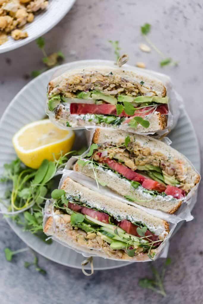perfect vegetarian sandwich with chickpeas, yogurt sauce, and fresh veggies
