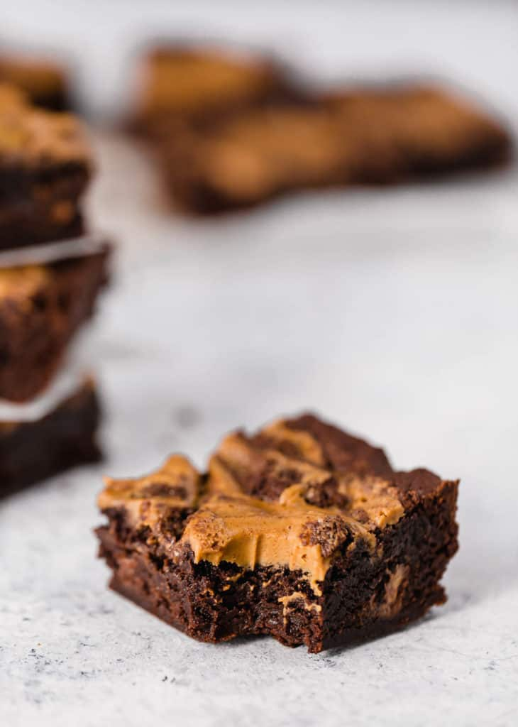 homemade chocolate peanut butter brownies on a white backdrop
