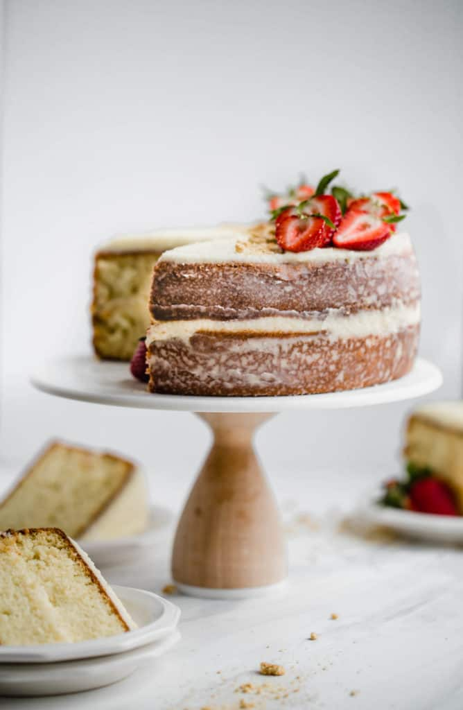 sliced simple vanilla cake with mascarpone frosting