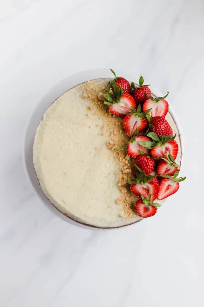 simple vanilla cake with mascarpone buttercream and sliced strawberries