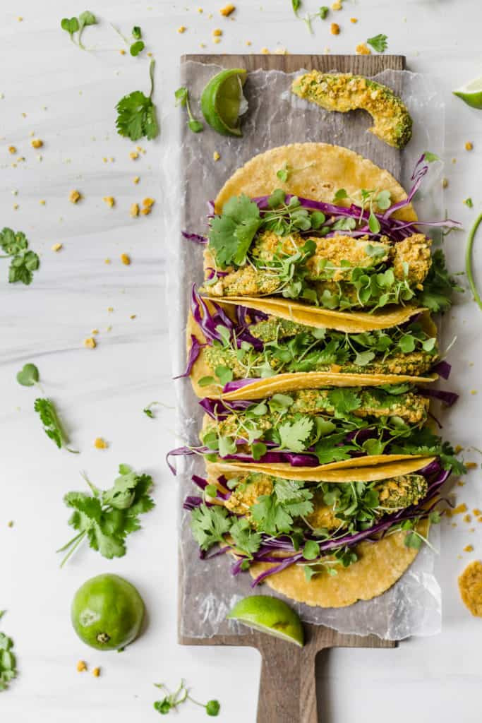 avotacos! plantain-crushed avocado tacos with cabbage, arugula micro greens, and all the cilantro!