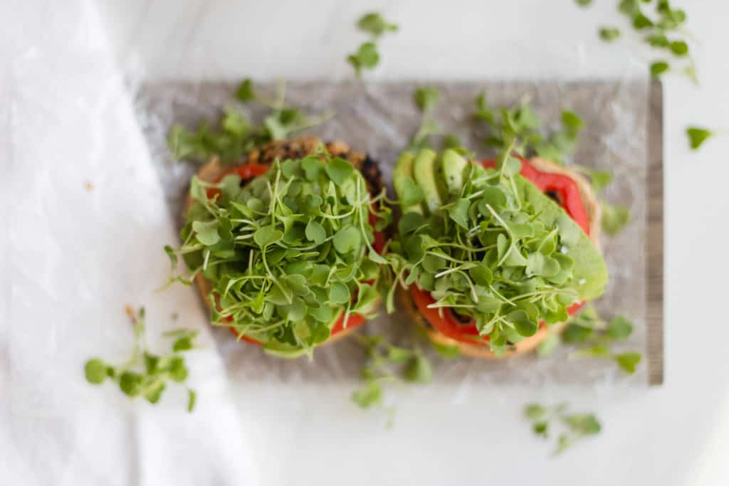 homemade black bean burgers piled high with arugula micro greens