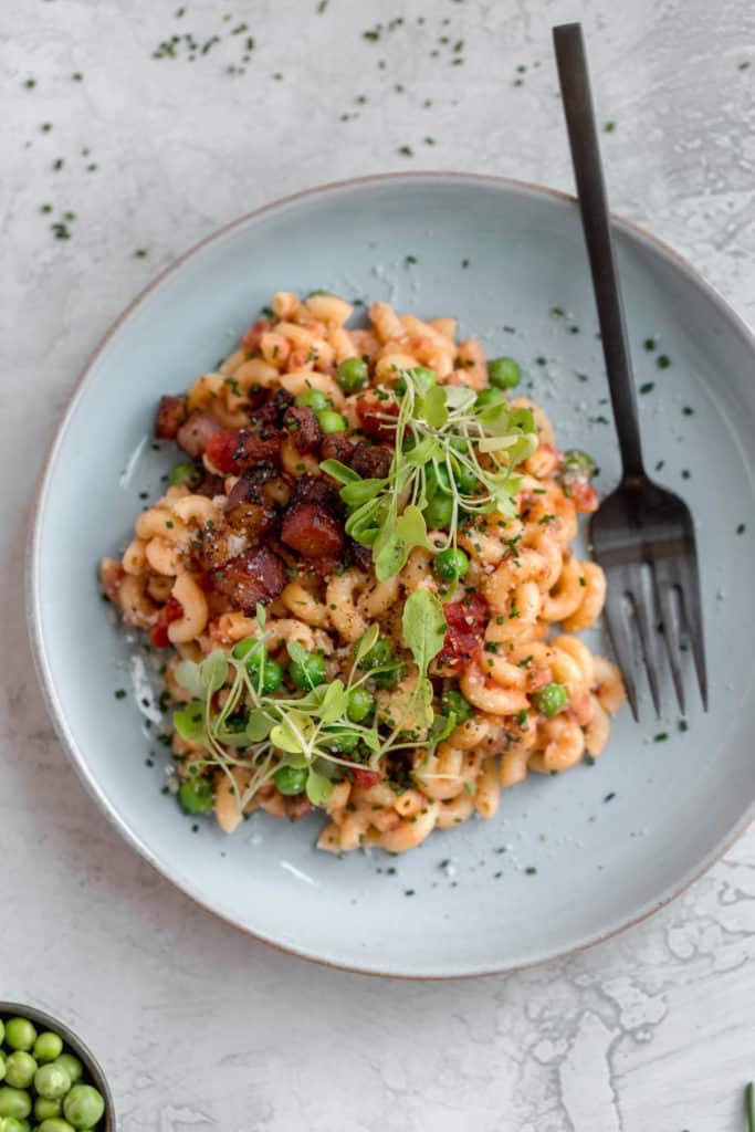 pancetta pasta with peas on a plate