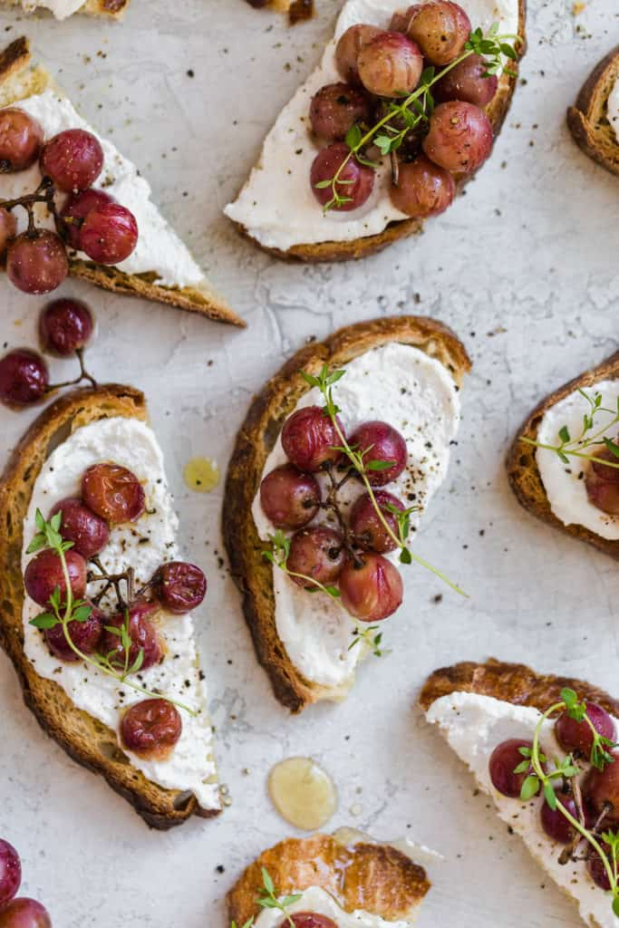 crispy crostini with roasted grapes and fresh ricotta cheese