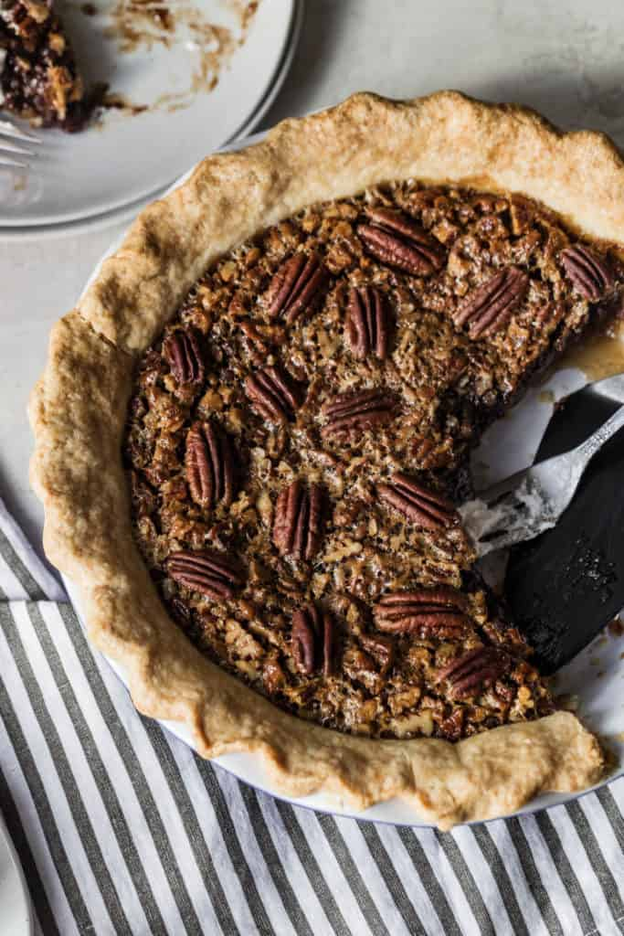 chocolate bourbon pecan pie with slices missing