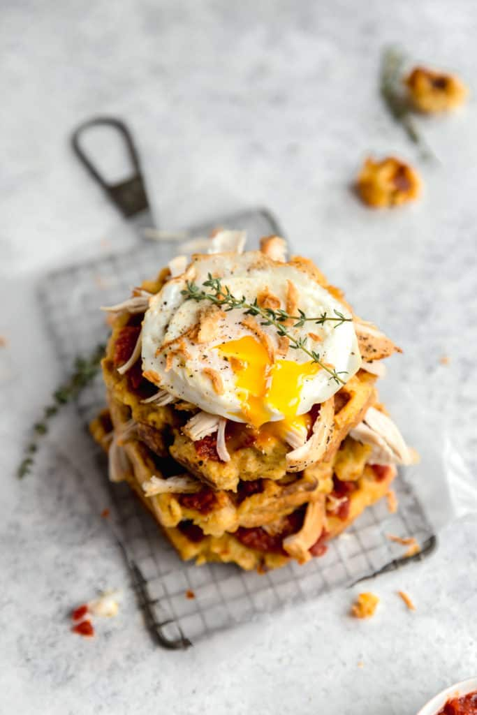 thanksgiving leftover recipe of stuffing waffles, turkey, and fried egg