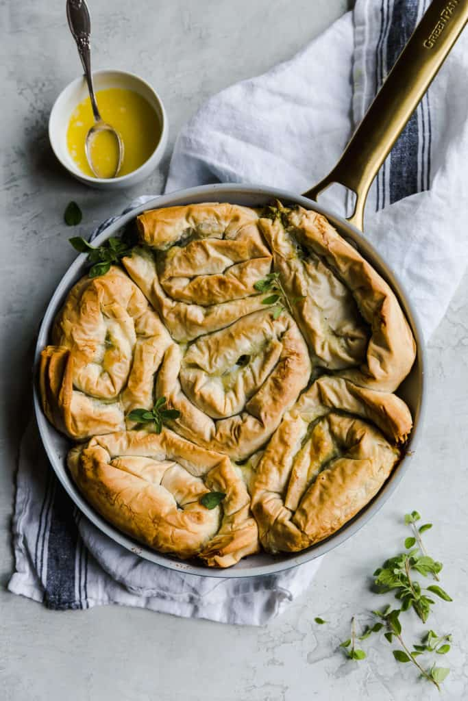 spanakopita spirals in a nonstick skillet after baking