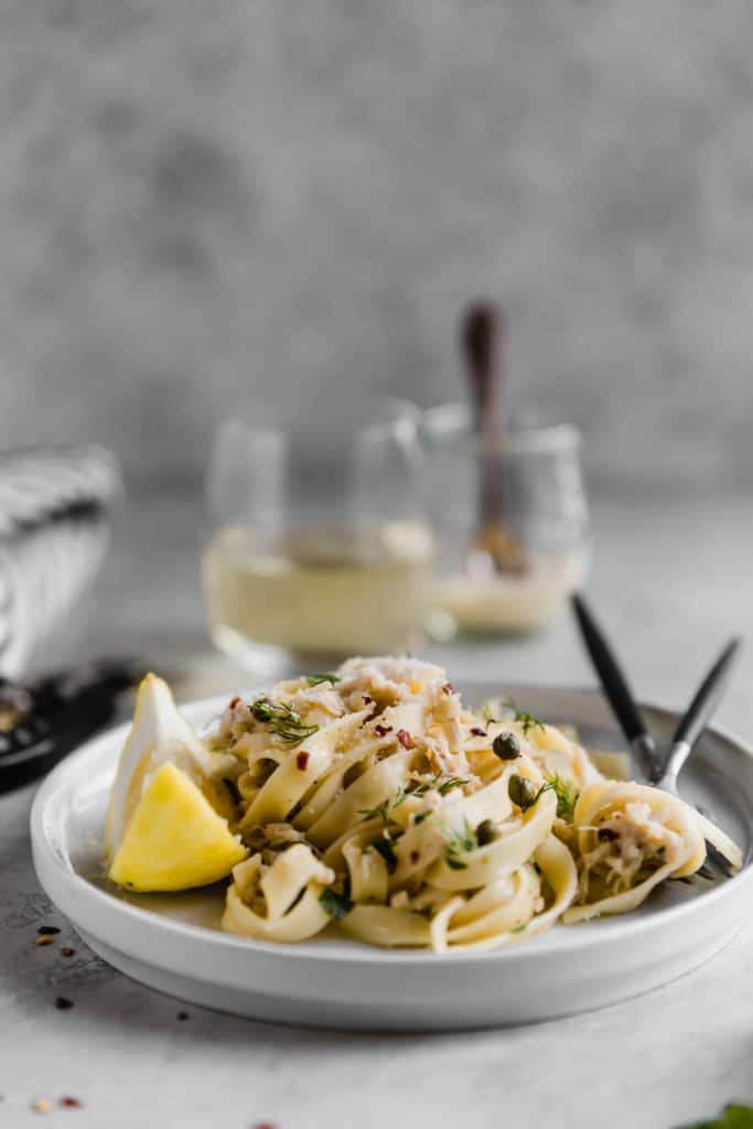 plate of lemon caper pasta with two forks