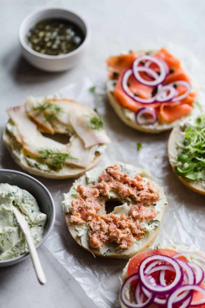 bagels, lox, cream cheese, and smoked seafood salads