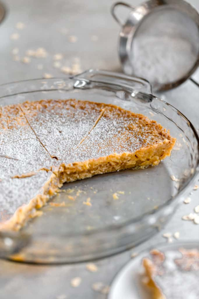 momofuku crack pie in glass pie plate with slices missing