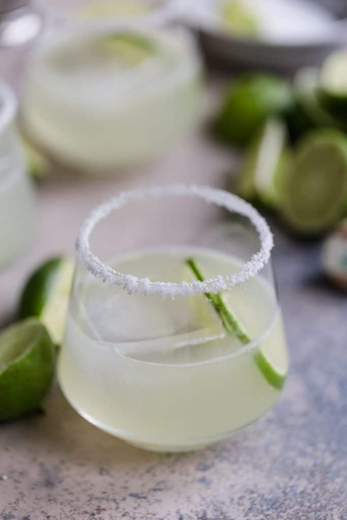 A close up of a Margarita with lime wedge