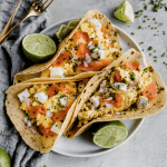 breakfast tacos with lox, eggs, and onion