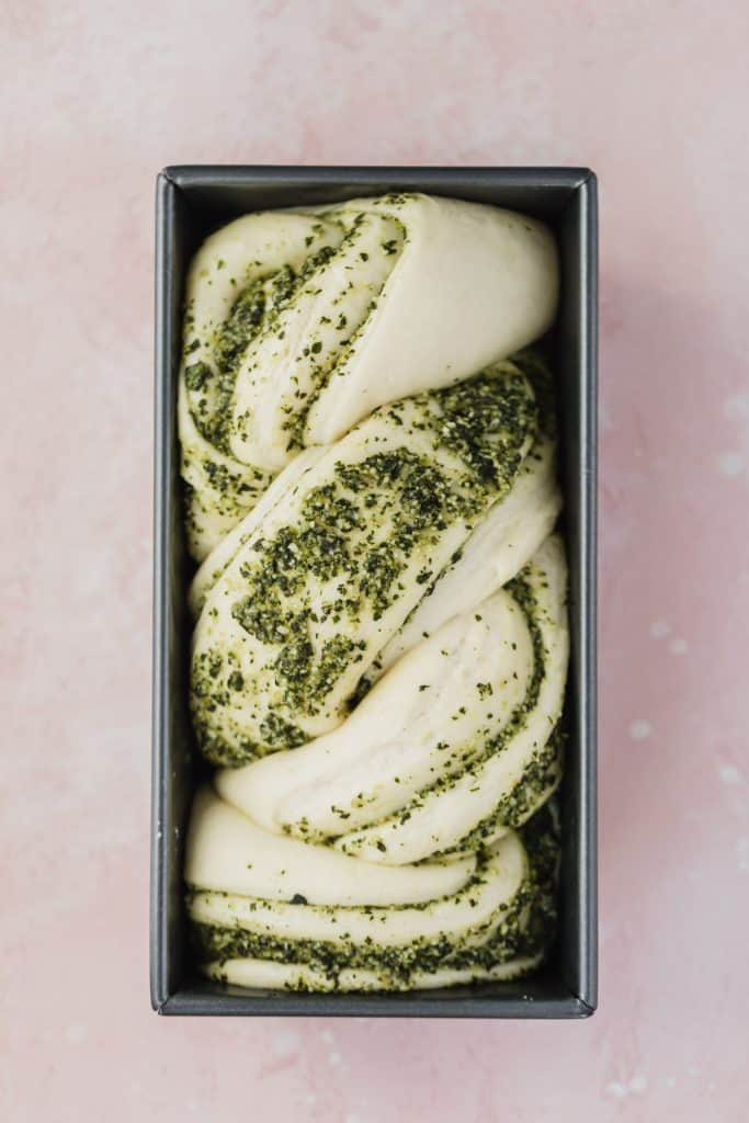 braided pesto loaf in loaf pan