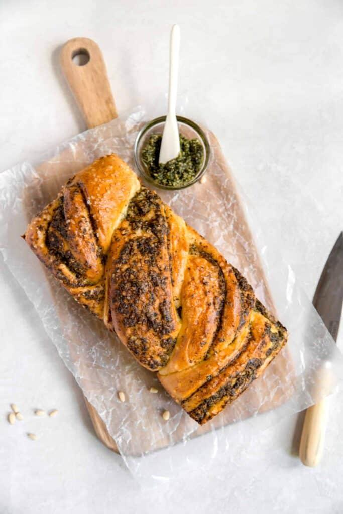 homemade braided pesto bread with extra pesto