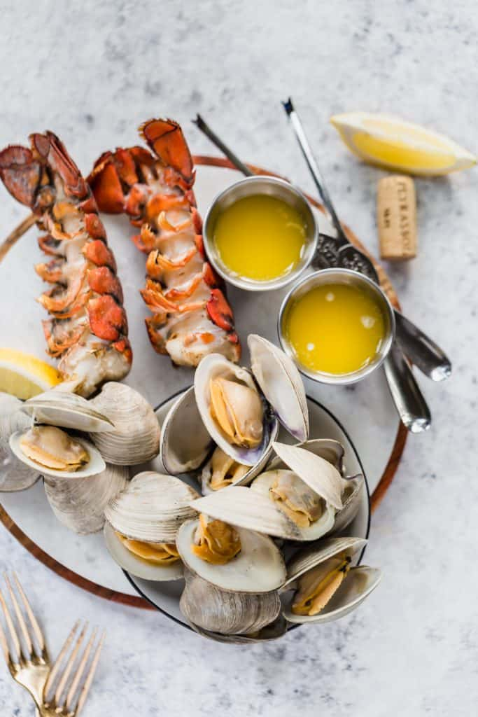Summer cookout with grilled lobster tails and clams