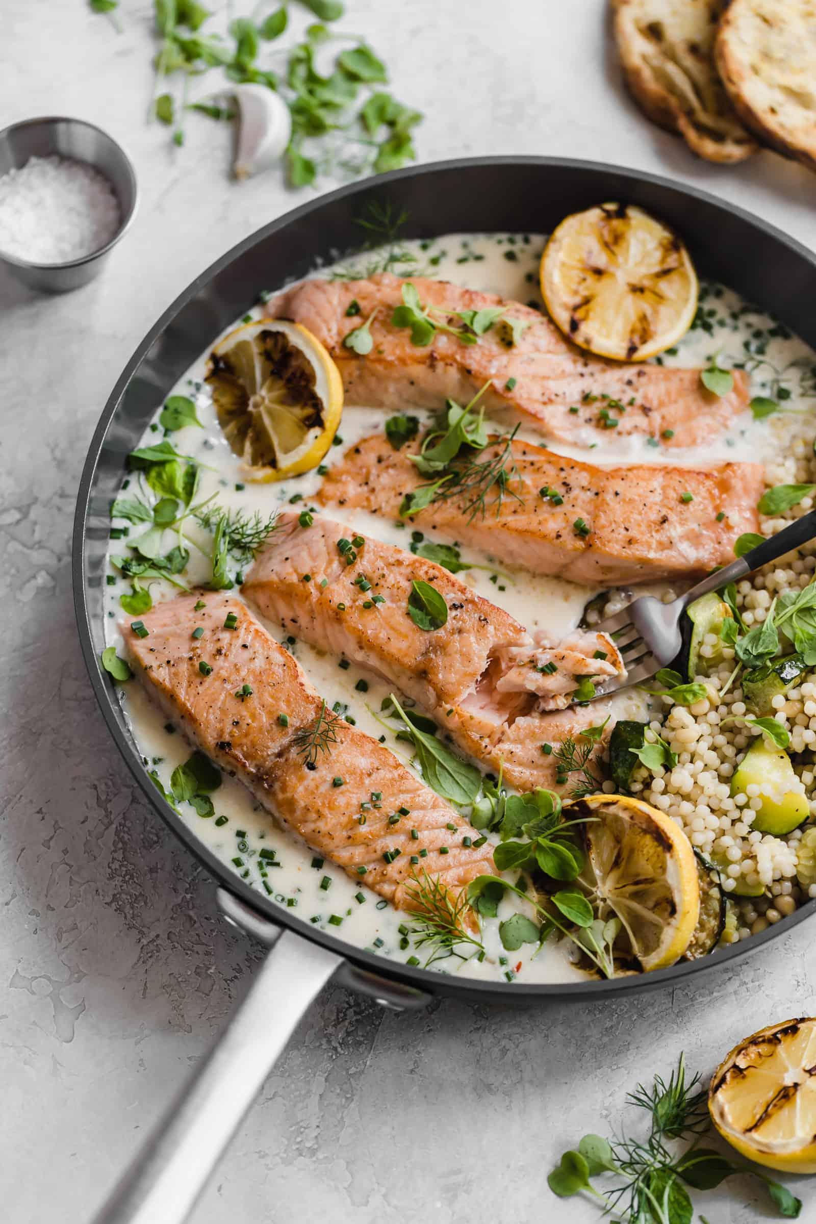 flaky salmon in parmesan herb pan sauce