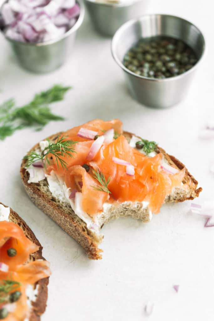 gravlax on pumpernickel with cream cheese, capers, red onion, and dill