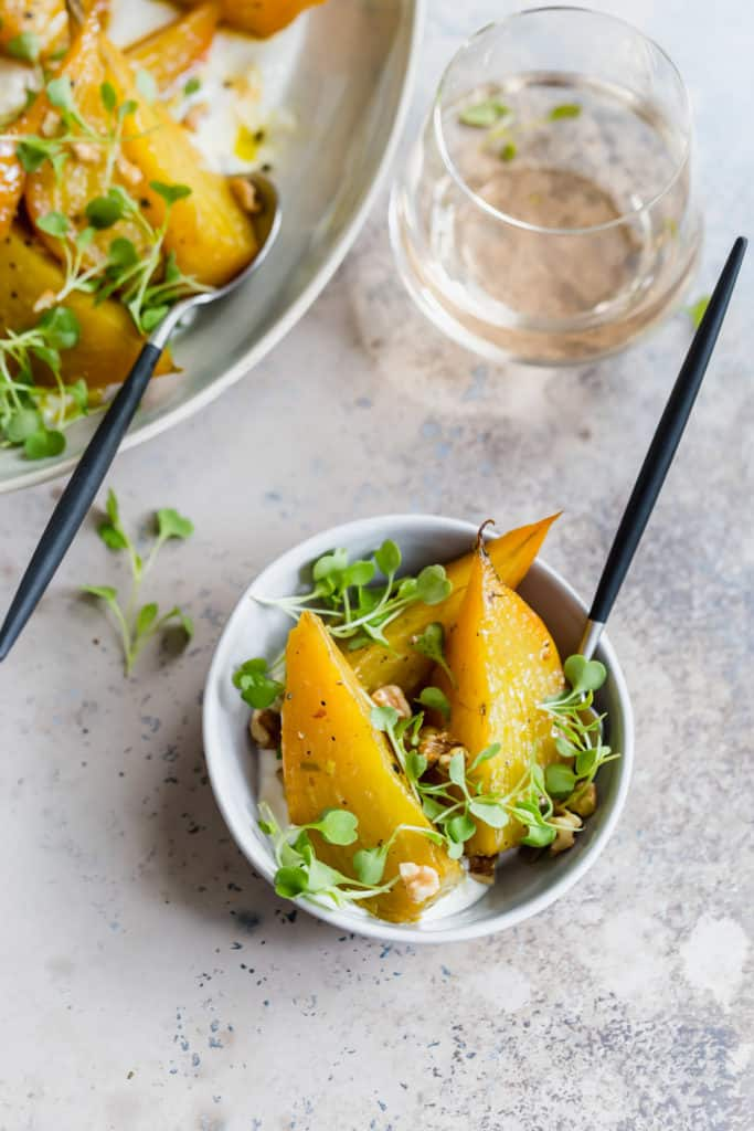 single portion of roasted golden beets with horseradish and arugula