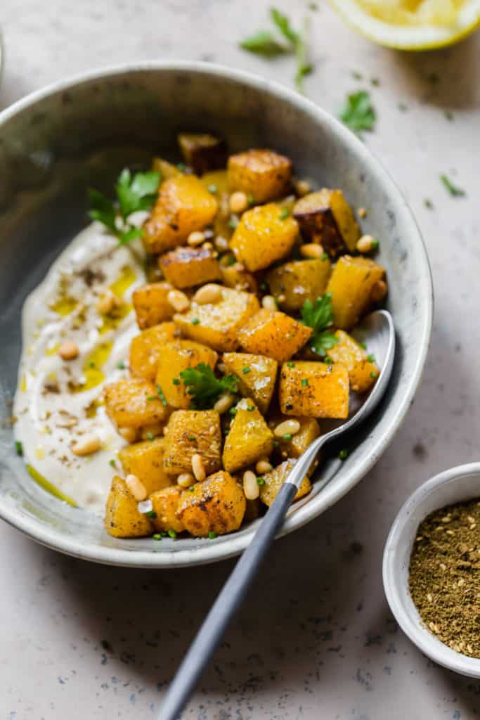 roasted butternut squash with za'atar and lemon tahini sauce and pine nuts