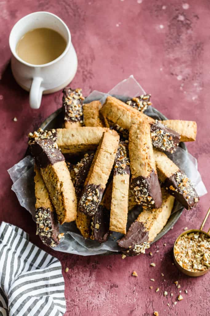chocolate dipped pecan biscotti with a cup of coffee