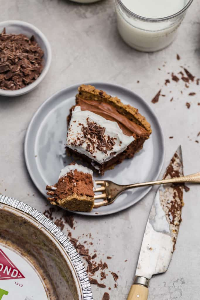 slice of no-bake chocolate mousse pie on grey plate