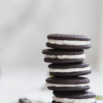 stacked chocolate sandwich cookies with mint and bourbon cream filling