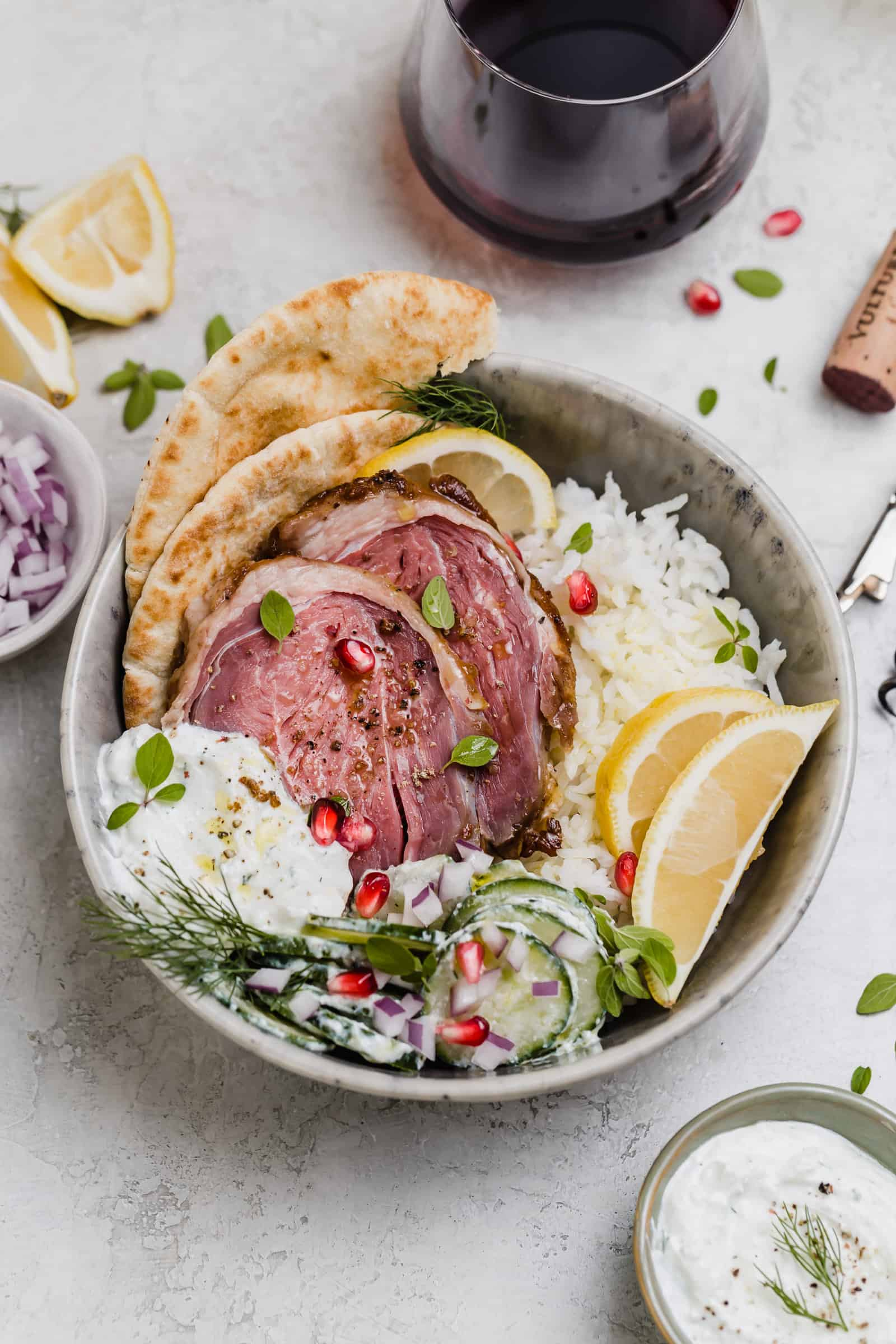 sous vide leg of lamb over rice with pita and cucumber salad