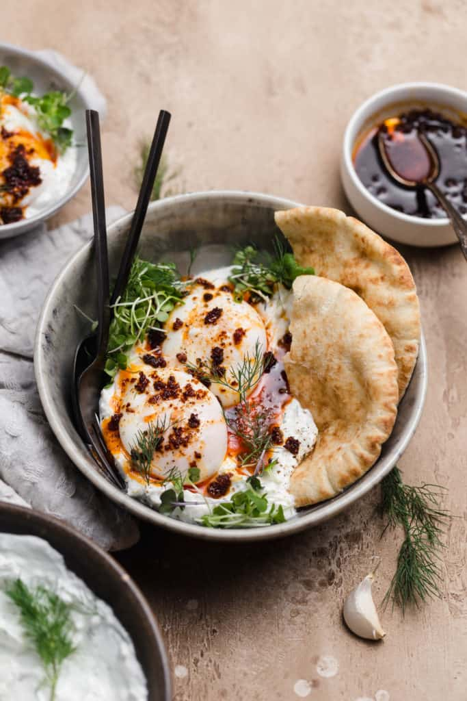turkish eggs with herbed ricotta yogurt sauce