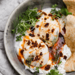 poached eggs with 'nduja on creamy herbed yogurt