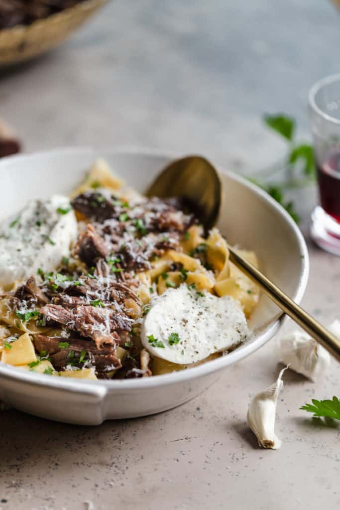 braised beef pappardelle in a pasta bowl with burrata