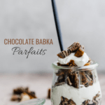 one chocolate babka parfait in a small jar with fresh whipped cream