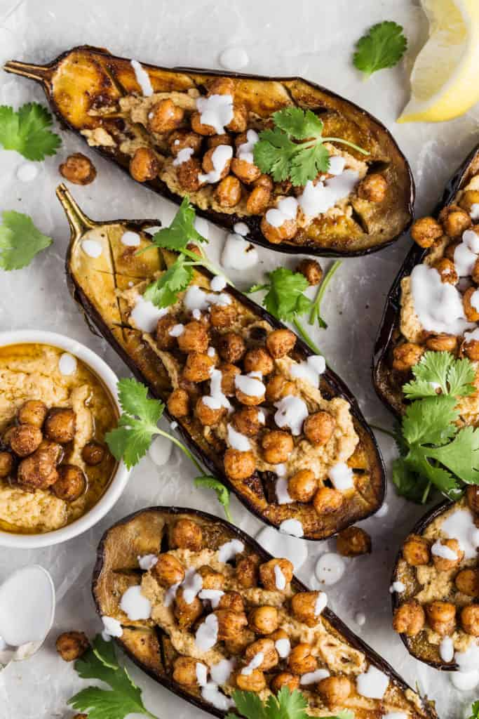 roasted eggplant with tahini and roast chickpeas on top