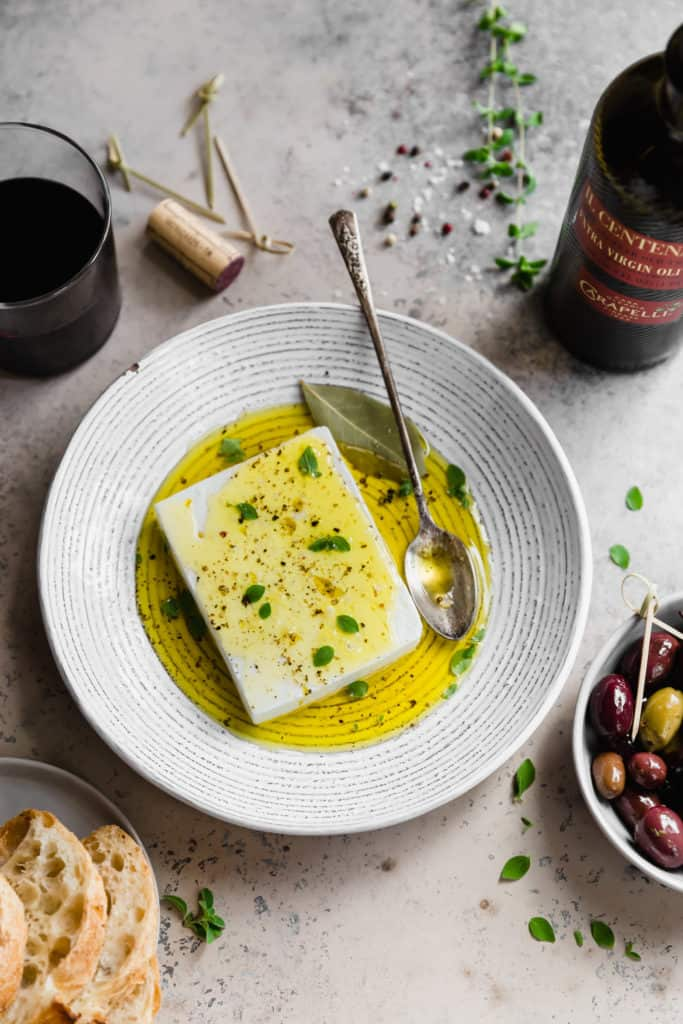 feta cheese with olive oil in a large bowl
