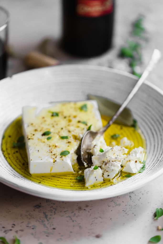 marinated feta in olive oil with thyme and sea salt