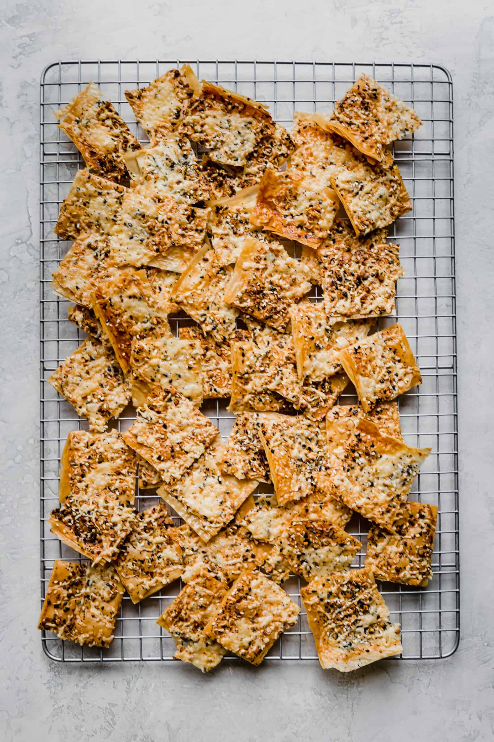 everything phyllo crackers on a wire rack