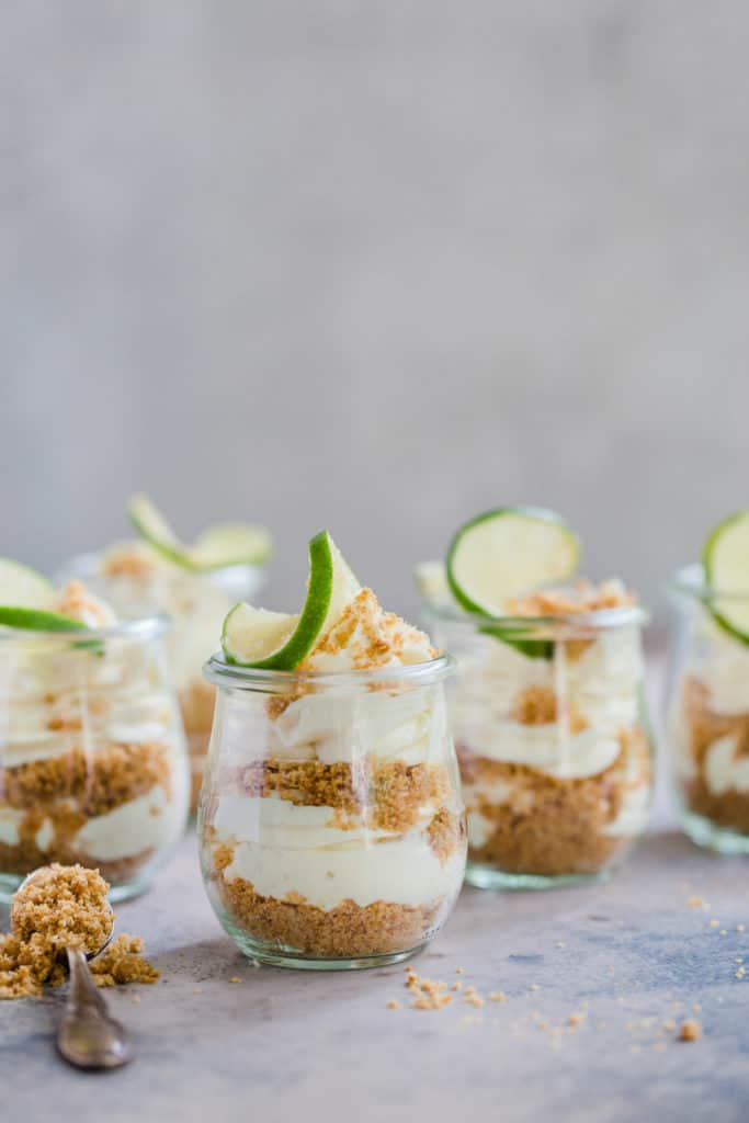 key lime cheesecake parfaits in small glass jars